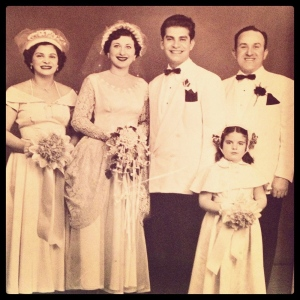 Aunt Anna on left and her husband Tommy on right standing up for her younger brother, Uncle Tommy, and his wife Hedy. Cousin Patricia is flower girl